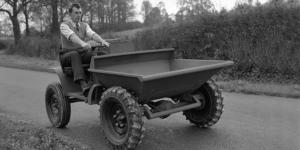 Black and white image of man on trucks - 1953